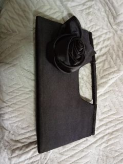Black purse with flower