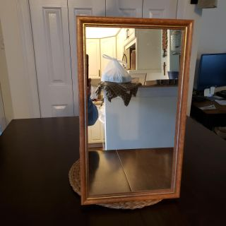 Mirror with wood trim