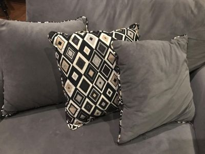Grey black and gold pillows