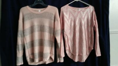 2 pink sweaters