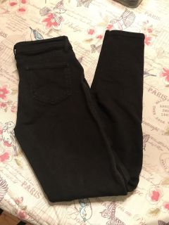 Black skinny jean like pants. A little stretchy. Size L but fits like S