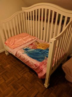 Convertible crib with mattress