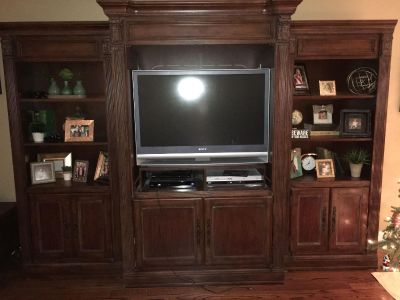 SOLID CHERRY ENTERTAINMENT CONSOLE AND 2 BOOKCASES FROM B F MYERS + 42 SONY TV in great shape. Doors close on console.