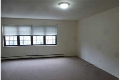 This two bedroom duplex is on a tree lined in Howard Beach.