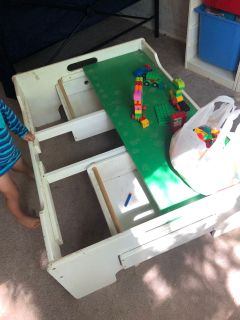 Train table and a bag of LEGO duplo s
