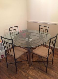 Glass dining table w/ 4 chairs.