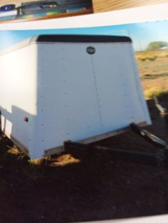 Closed 5 by 8 utility trailer with spares