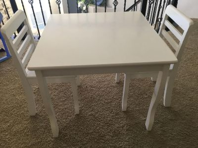 Jardine kids white wood table and 2 chairs. Very sturdy set. Has nicks in the paint from normal wear & tear. Measurements in comments.