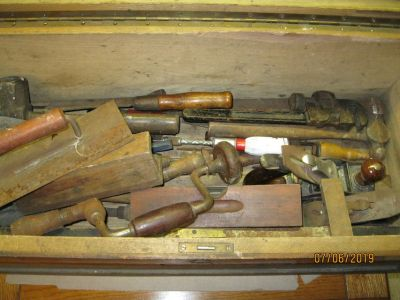 VERY LARGE ANTQ WOODEN TOOL BOX WITH 39 TOOLS.