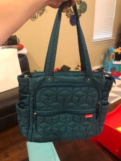 Teal SkipHop diaper bag w/ changing pad.