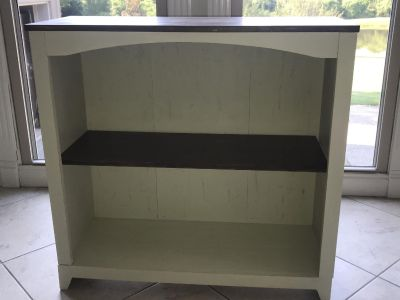 Refurbished and distressed farmhouse style bookcase or TV hutch