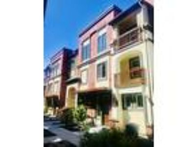 Roommate wanted to share Four BR 3.5 BA Townhouse...