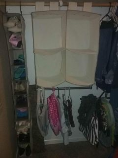 Hanging closet organizer has 4 cubes as well as below pole for hanging