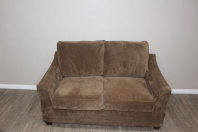Very comfortable and plush brown Loveseat