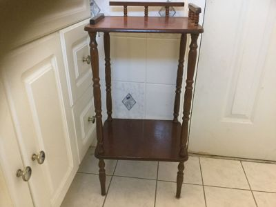 Very sturdy tall wood antique 2 layered side table.