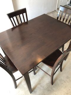 Wooden dining table w/ 4 chairs
