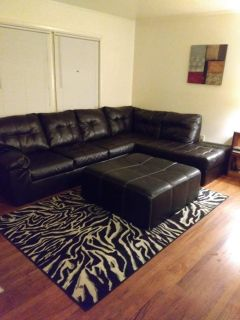 Black leather sectional sofa / couch