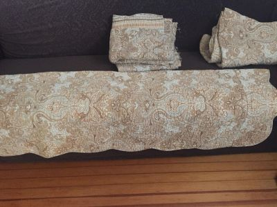 2 quilted foot warmers that go on the end of twin beds. They were trimmed from a larger coverlet. Extra fabric could be made into pillows.