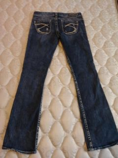 Silver Tuesday size W26/L33 jeans boot cut with factory cut on bottom and wholes in the front. Really cute jeans!