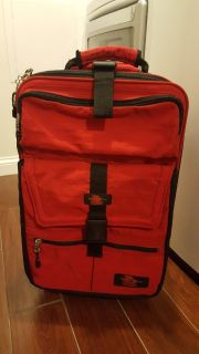 Kiva sports red suitcase with wheels