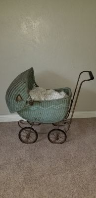 Antique wicker doll buggy