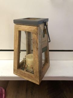 NWT wooden and metal lantern. 17 inches tall with the handle