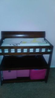 Sturdy wood changing table.