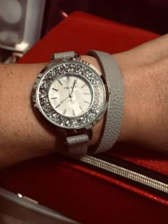 Cute gray wrap around sparkly watch with pearl face. Just needs new battery. Worn once