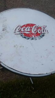 Coca-cola table..some damage on top ..