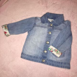 Carters 12-Month Light Colored Jean Jacket W/ Floral Print On The Inside.