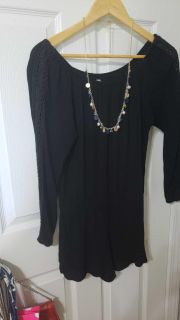 Black romper. Necklace not included.