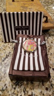 Henri Bendel Decorative Compact. New in the Box. Comes with Original Bag. Compact has 1 Regular Mirror and 1 Magnifying Mirror.