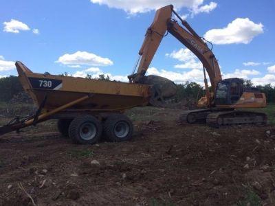 2015 Caterpillar 730 Rock Box Dump Trailer