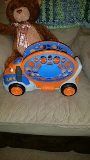 Large toy car carrier, side folds down for cars to load on