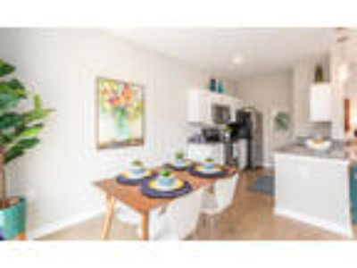 Woodland Acres Townhomes - Three BR, 2.5 BA Townhome 1,395-1,405 sq. ft.