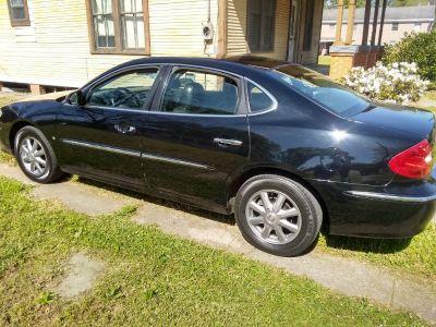 2009 Buick Lacrosse 4 door.... Black with Black interior