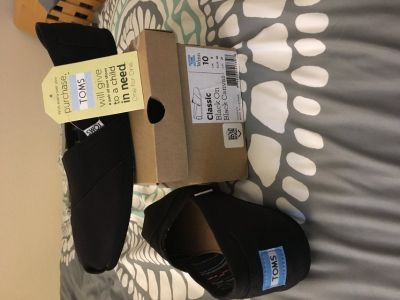Women s TOMS black shoes - Size 10 **never worn**