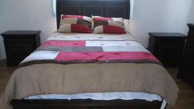 Brand new full-size bed end tables and dresser with mirror all matching three comforters never used must sell moving