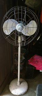 Armoire, vintage Schwinn bikes, large mirrors, large metal fan and lots of chairs.