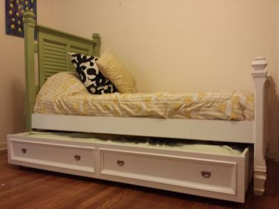 Wood twin bed with wood trundle from Rooms to go. No mattresses