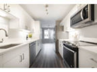 This great Three BR, Two BA sunny apartment is located in the area on Village Wa