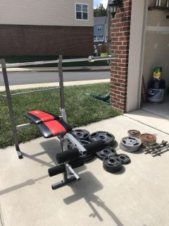 Weight bench, barbell, two hand barbells, 300 pounds newer weights, 60 pounds older weights