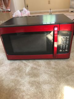 Red microwave, less than a year old