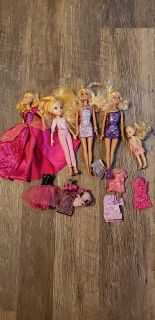 Random barbie dolls and outfits