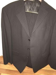 Beautiful black pin striped suit - coat is a 46 regular and pants are a 36 regular