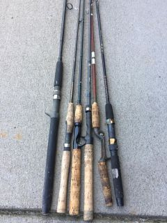 Six fishing rods. 4 with cork handles. Some vintage.
