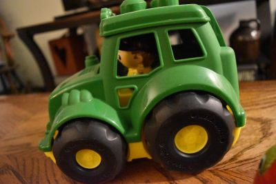 John deere toy tracter with man inside of it!