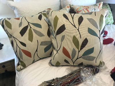 Set of two larger style pillows. Brand new. Came with loveseat but don t need. $8