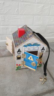 Wood toy house with different locks and keys