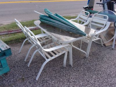 Glass Top Table, Four Chairs and Umbrella Patio Set
